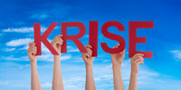 People Hands Holding Word Krise Means Crisis, Blue Sky