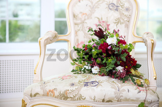 Wedding bouquet with succulent flowers and hops in retro style on a chair