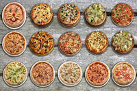 Set of 15 pizza on wooden background. Image of fast food for menu card, web design, site, shop, advertising or delivery.