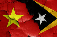flags of Vietnam and East Timor painted on cracked wall