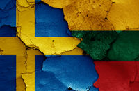 flags of Sweden and Lithuania painted on cracked wall