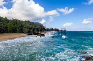 Aerial drone shot of Lumahai Beach on the north shore of Kauai in Hawaii