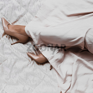 Woman's legs in beige high-heels shoes and long silk dress, fashion and luxury lifestyle