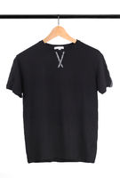 black T-shirt on a hanger on a white background