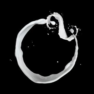 milk splash isolated on black