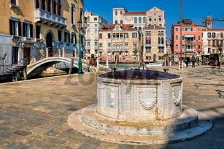 Venice, Italy - 03/15/2019 - old fountain in the dorsoduro district