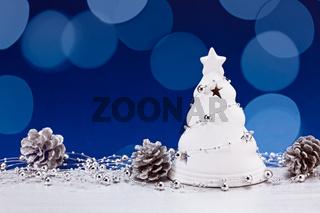 Christmas tree figurine with fir cones