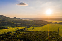 Sun shining over forested hills of Little carpathians on summer evening