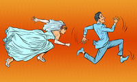 The groom runs away from the bride. A comical chase. Wedding
