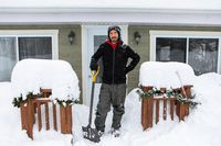 portrait of man while shoveling the snow