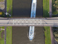 Aerial view of a bridge over a river with a water way river running underneath