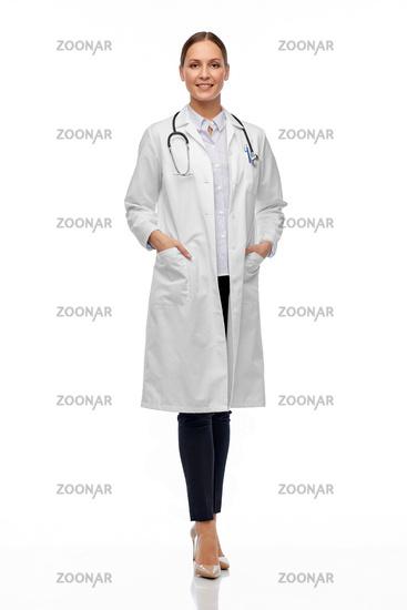 happy smiling female doctor in white coat