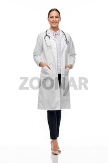 happy smiling female doctor in white coat