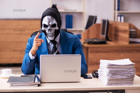 Devil businessman working in the office