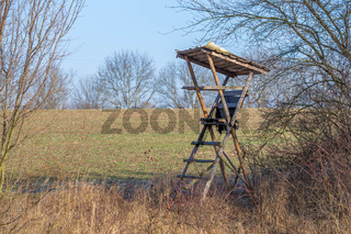 Wildlife observation point - raised blind or hunting tower near meadow