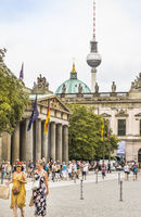 street scene in front of neue wache, new gardhouse, berlin cathedral and television tower in background