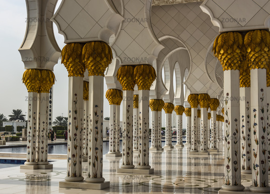 The arcades of the Sheikh Zayed Grand Mosque flanked by thousands of columns