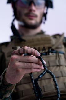 soldier praying tespih