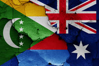 flags of Comoros and Australia painted on cracked wall