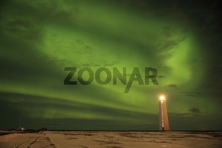 Aurora above the lighthouse on Gardskagi, Keflavik, Iceland