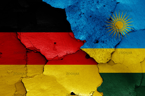 flags of Germany and Rwanda painted on cracked wall