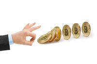 Hand and falling bitcoins