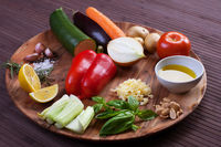 Ingredients vegetables for soup with pesto sauce and basil on a wooden plate. Soup boul