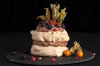 Chocolate cake pavlova with mixed fruit.