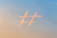 Hashtag sign in the sky made out of contrails