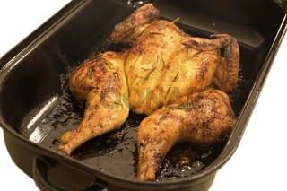 Plattes Huhn im Bräter
