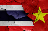 flags of Thailand and Vietnam painted on cracked wall