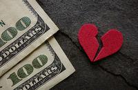 Broken red heart money