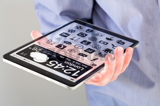 Tablet with transparent screen in human hands.