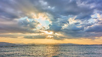 Sea and sky with colorful clouds at sunset