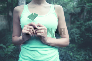 Lady with ginkgo biloba leaf