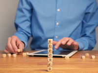 Concepual success business image with small wooden blocks