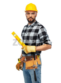 male worker or builder in helmet with level