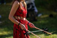 Lady uses devil sticks at earth festival