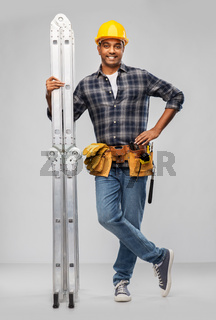 happy indian builder in helmet with ladder