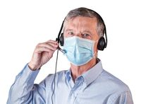 Senior man with face mask using headset to communicate with team or customers