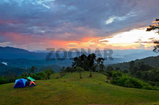 Sunset over hills at campsite on the high mountain