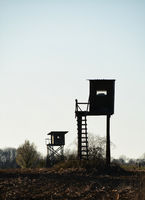 Watch towers on a border in a field