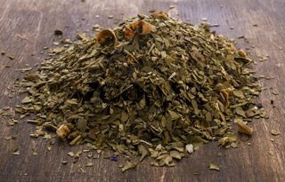 Dry mate tea on wooden background