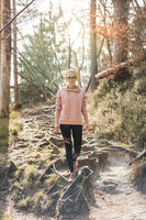 Young fit woman hiking in nature. Adventure, sport and exercise.