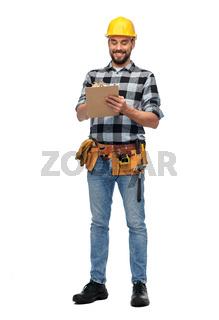 male worker or builder in helmet with clipboard
