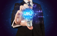 Businessman holding a light bulb, new business concept