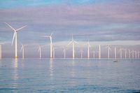 Windmills for electric power production Netherlands Flevoland, Wind turbines farm in sea, windmill farm producing green energy