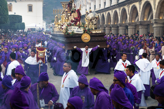 Float with Christ and the cross carried by purple robed men at the procession San Bartolome de Becerra, Antigua, Guatemala