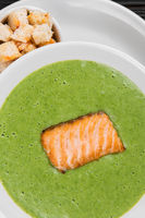 Delicious green broccoli cream-soup with salmon
