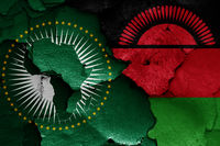 flags of African Union and Malawi painted on cracked wall